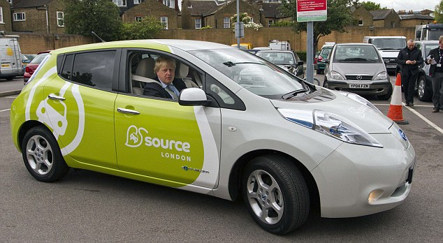 Mayor Boris Johnson driving an electric car into an ASDA car park in Kingston launches 'Source London'  the first ever city wide charge point network for electric car drivers ..... Picture with Quentin Wilson